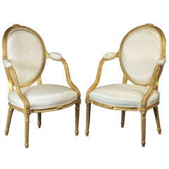 A Fine Pair of George III Giltwood Oval Backed Armchairs