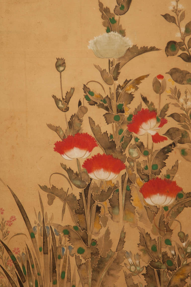 Late Rimpa School painting of a variety of flowering plants:  peony, magnolia, poppy, chrysanthemum, mukuge and hyacinth. Three panels bear a circular red seal (unclear). Ink and pigments on paper applied to gold foil paper.