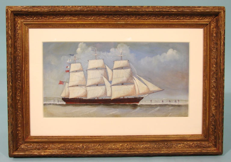 A nicely painted English watercolor of a 3 masted sailing ship flying the Union Jack. With a period gilt composition frame.