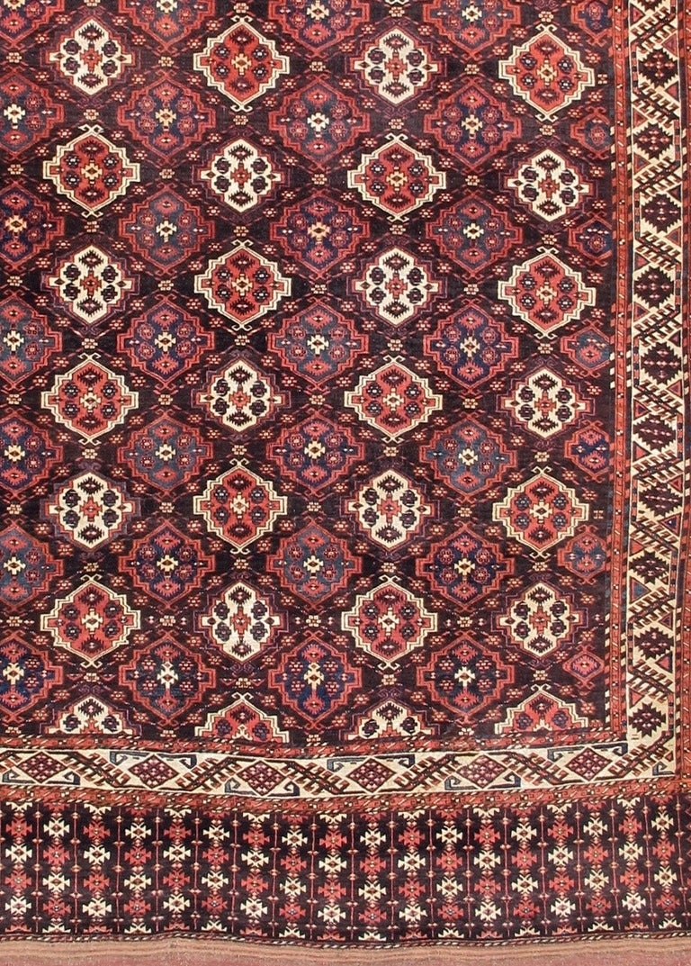 From the Chodor tribe of Turkmenistan, this handsome piece exemplifies the Turkmen weaver's genius for creating maximum beauty from a locale with a minimum of available dyestuffs and raw materials. The term 'main carpet' differentiates these tent