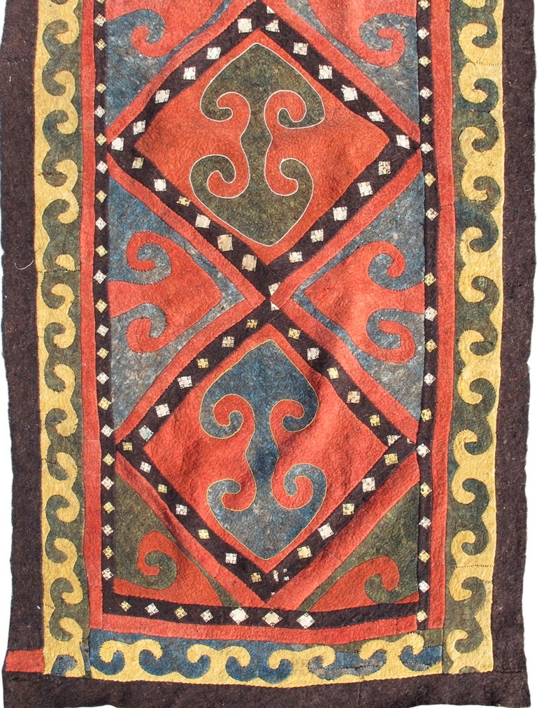 This truly tribal antique felt represents one of the oldest crafts practiced by man since the domestication of sheep and one vital to life on the often harsh Eurasian steppe. Central Asian felt carpets are made by sewing colorful reciprocal felt
