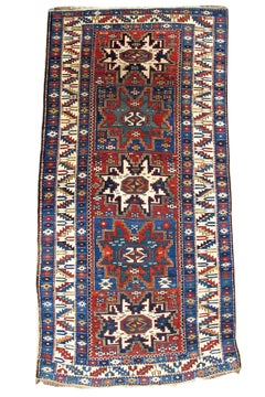 Late 19th Century Varied Red and Blue Lesghi Star Kuba Rug