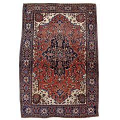 19th Century Red Fereghan Sarouk Rug with Indigo Central Medallion