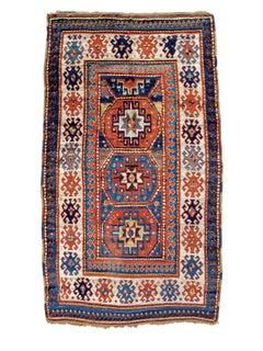 Late 19th Century Geometric Red Caucasian Kazak Rug with Three Medallions