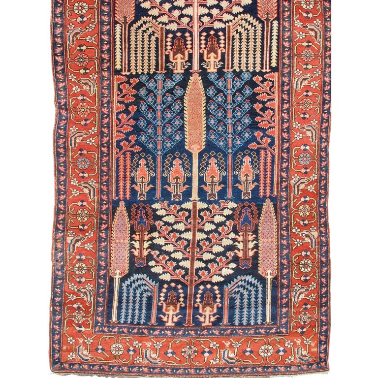 Late 19th Century Red and Indigo Northwest Persian Long Rug with Floral Elements