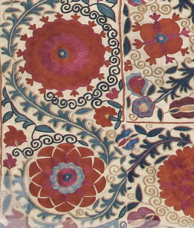 'Suzani' means needlework and these embroideries are some of the most characteristic forms of textile art from Central Asia. This piece was stitched in one of the oasis towns of Uzbekistan during the first half of the nineteeth century. Bold flowers