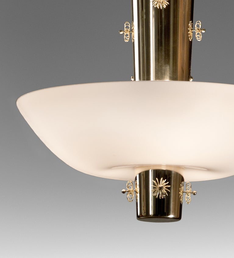 A Brass and Opaline Glass Chandelier by Paavo Tynell 4