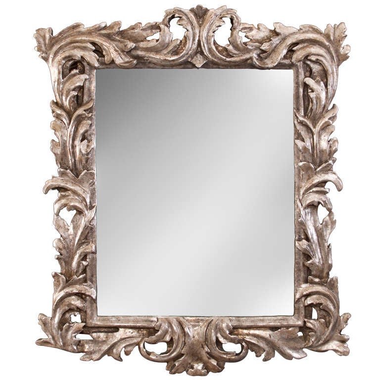 An italian baroque foliate carved silvered wood mirror at for Italian baroque mirror