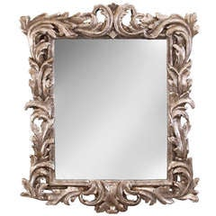 An Italian Baroque Foliate Carved Silvered Wood Mirror
