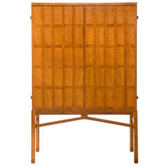 Carl-Axel Acking: A Swedish Walnut Two Door Cabinet on Stand