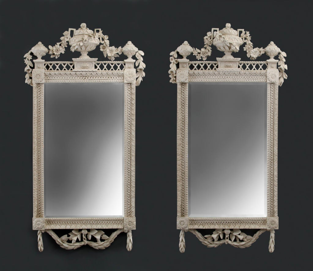 A Pair Of North German Neoclassical Carved Wood Mirrors At