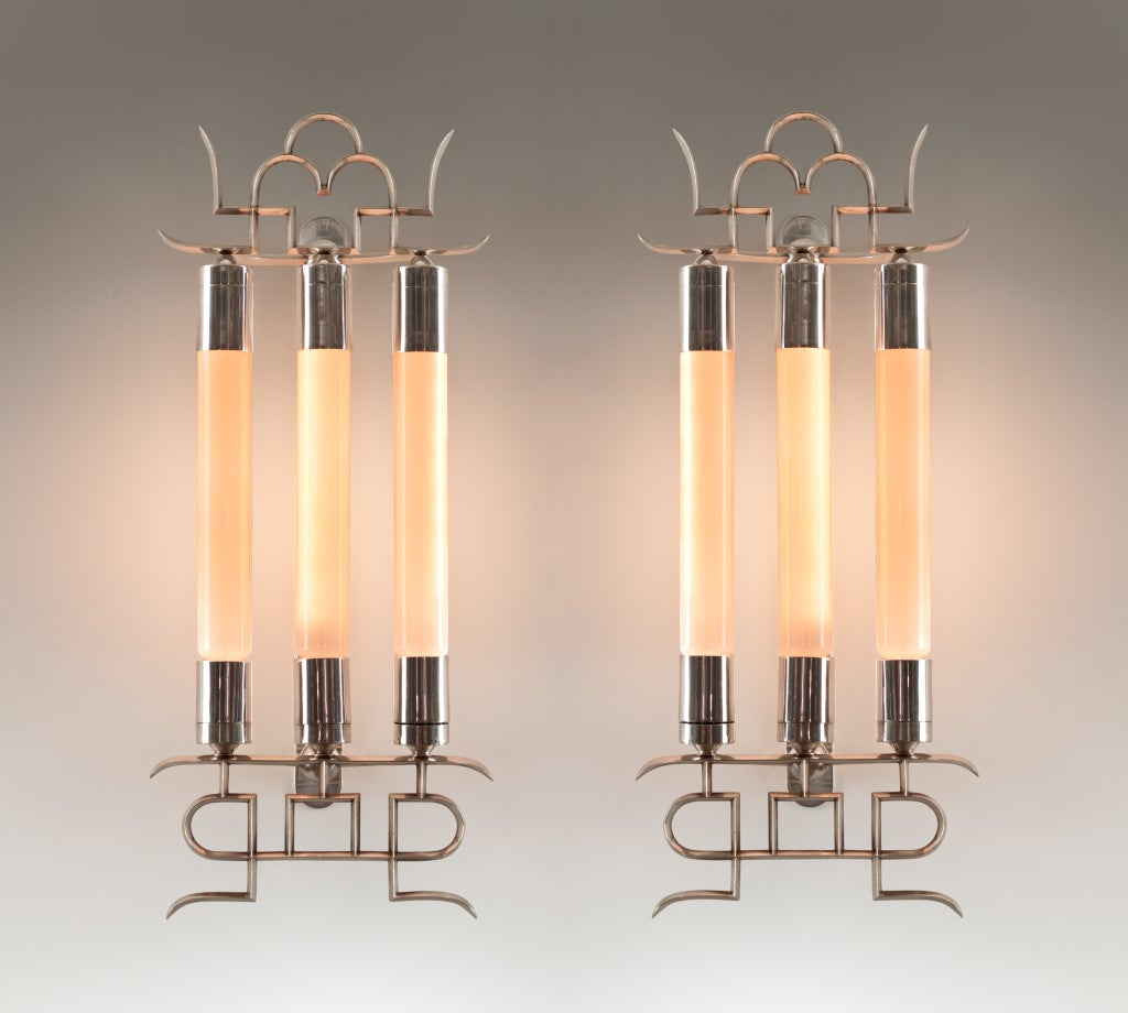 Each with a fretwork crown, surmounting three capped lightholders, over a fretwork base. Produced by Donzelli.
