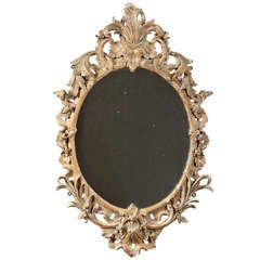 A Fine Carved And Gilt Oval Rococo Mirror