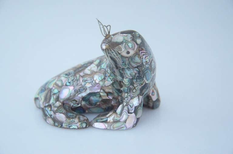 Being offered is a circa 1960 silverplate and abalone seal by Los Castillo, of Taxco, Mexico.  Dimensions 3 3/4 inches high, length 4 1/2 inches long, 3 1/4 inches wide.  Marked.  In excellent condition.