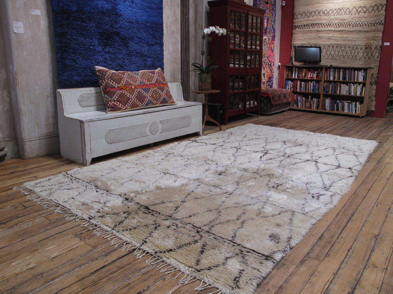 A superb old Moroccan Berber carpet of rare, large proportions, by the Beni Ouarain tribes. The classical diamond grid design is executed with great dynamism, featuring many interruptions and whimsical details. The weave is dense, the wool quality