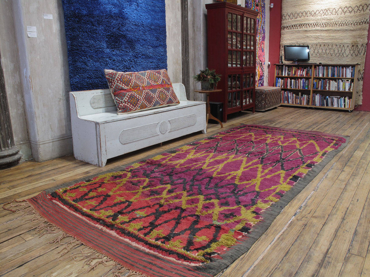 A fascinating Moroccan Berber carpet, attributed to the Ait Bou Ichaouen tribes. Working within the traditions of her tribe, the weaver nonetheless created her unique interpretation of age-old themes that defies simplistic explanations.  At the