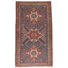 "Antique ""Sunburst"" Sumak Carpet"