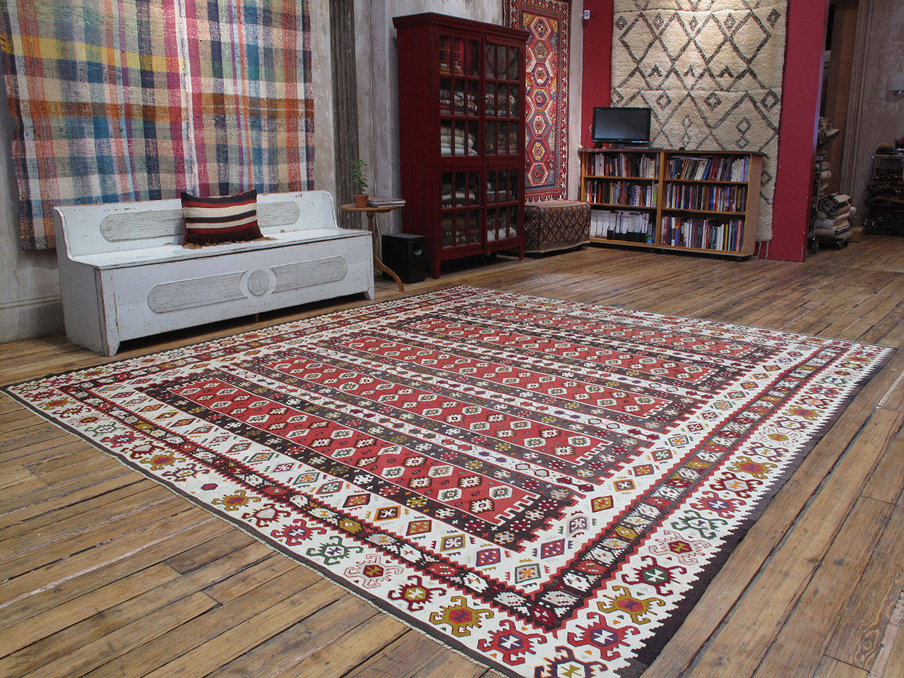 Balkan Kilim rug. An old flat-woven rug in large, square-ish format from the border region between Serbia and Bulgaria, where the tradition of weaving large Kilims goes back for centuries. This rug is a high quality example featuring a well-known