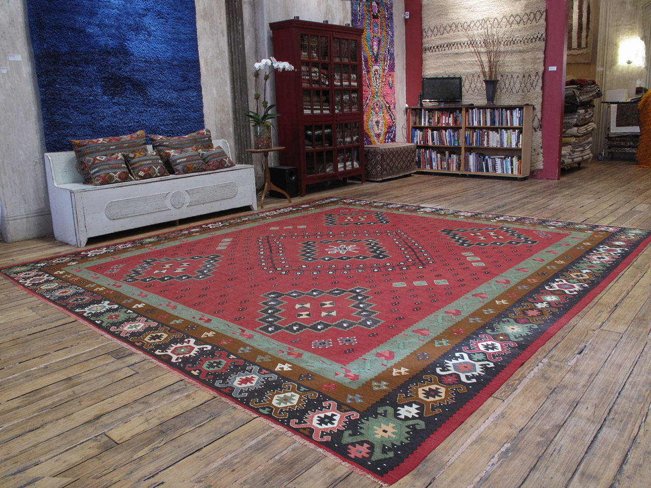 A beautiful old kilim of large and square-ish proportions from the border region between Serbia and Bulgaria, which has a centuries-old tradition of kilim weaving, older examples from the region are called Sharkoy, the old Turkish name of the town