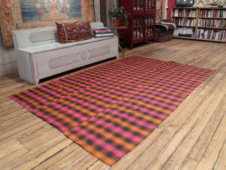Plaid cover rug. A lovely old flat-weaver ug from Western Turkey, woven in panels on a narrow loom. Rug can be used as a floor cover in a low traffic area, but it is also light enough to be used as a bedspread. Rug has great color variations and