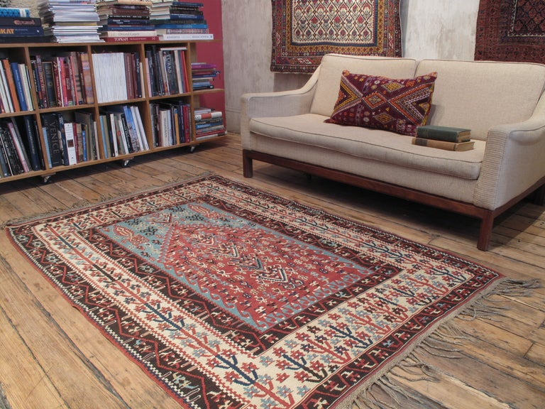 A fantastic antique kilim from Eastern Turkey, featuring an elegant rendition of the prayer arch. Fine and delicate, these kilims were sought after by, and made for wealthy local patrons and were mostly used as prestigious wall hangings.