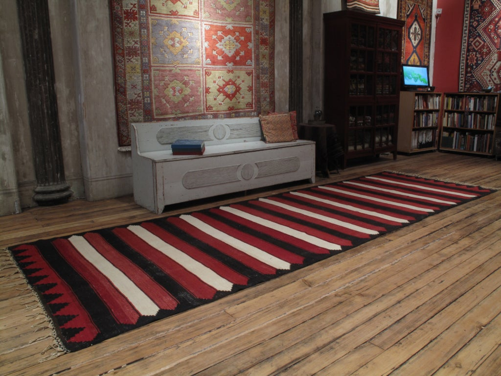 Red, white and black Kilim 'Wide Runner' rug. An old tribal Kilim runner from Central Turkey with striking graphics. A rare and unusual type of rug.