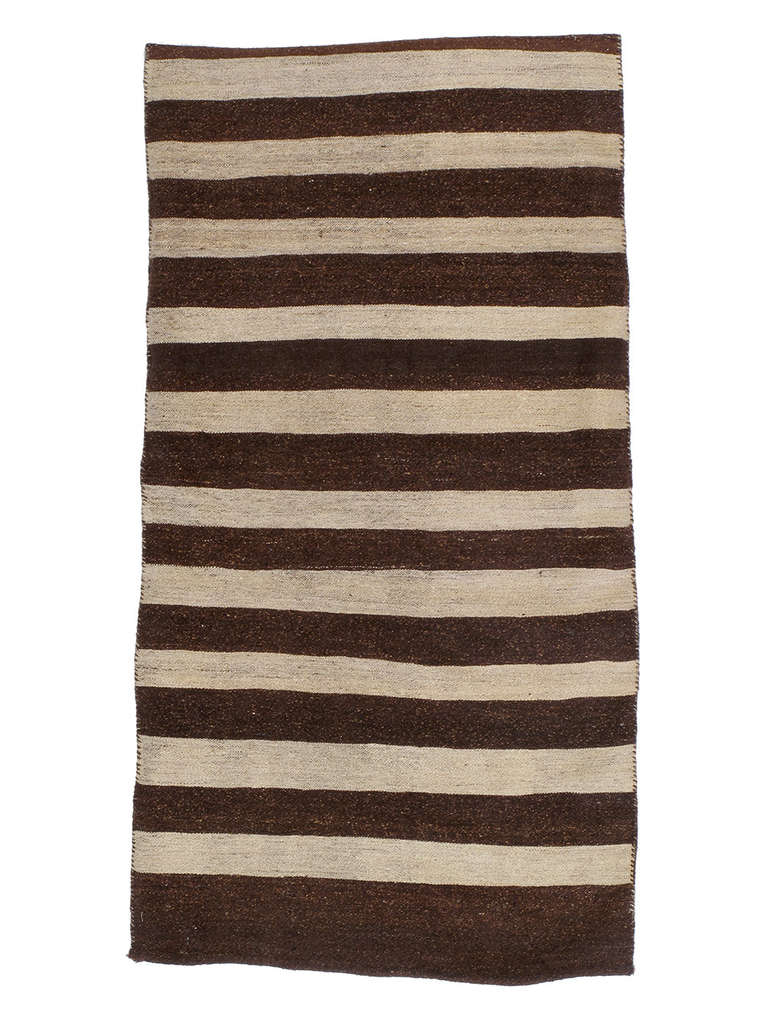 Grain Sack rug. An old tribal cargo bag or rug with very colorfully decorated front and flat-woven brown and ivory back. It can be used as a sturdy floor rug or easily made into a large cushion.