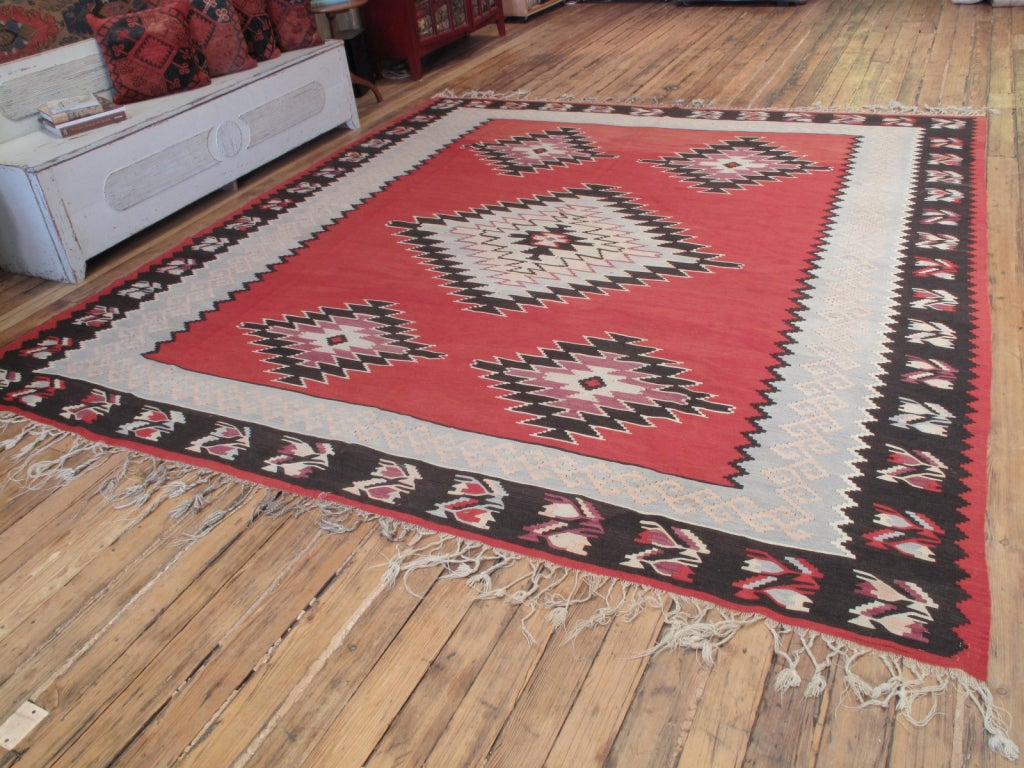 Balkan Kilim rug. A very nice old kilim rug from the Balkans in square-ish format. The blue-gray inner border of the rug is unusual.