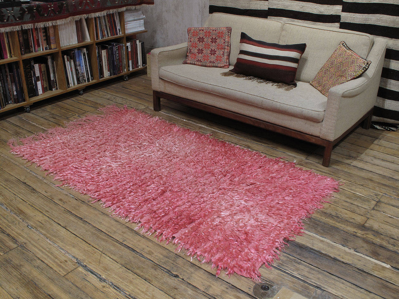 A simple old tribal rug from West-Central Turkey, woven with coarsely knotted tufts of angora goat hair (mohair), used to provide warmth and comfort. The color has mellowed with age and it has been hard to capture with our camera, but it can best be