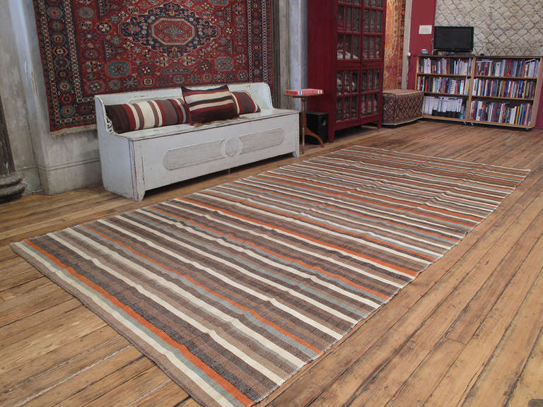 A lovely old flat-weave from Western Turkey, woven in panels on a narrow loom. It can be used as a floor cover in a low traffic area, but it is also light enough to be used as a bedspread. Great color variations and fantastic old patina.