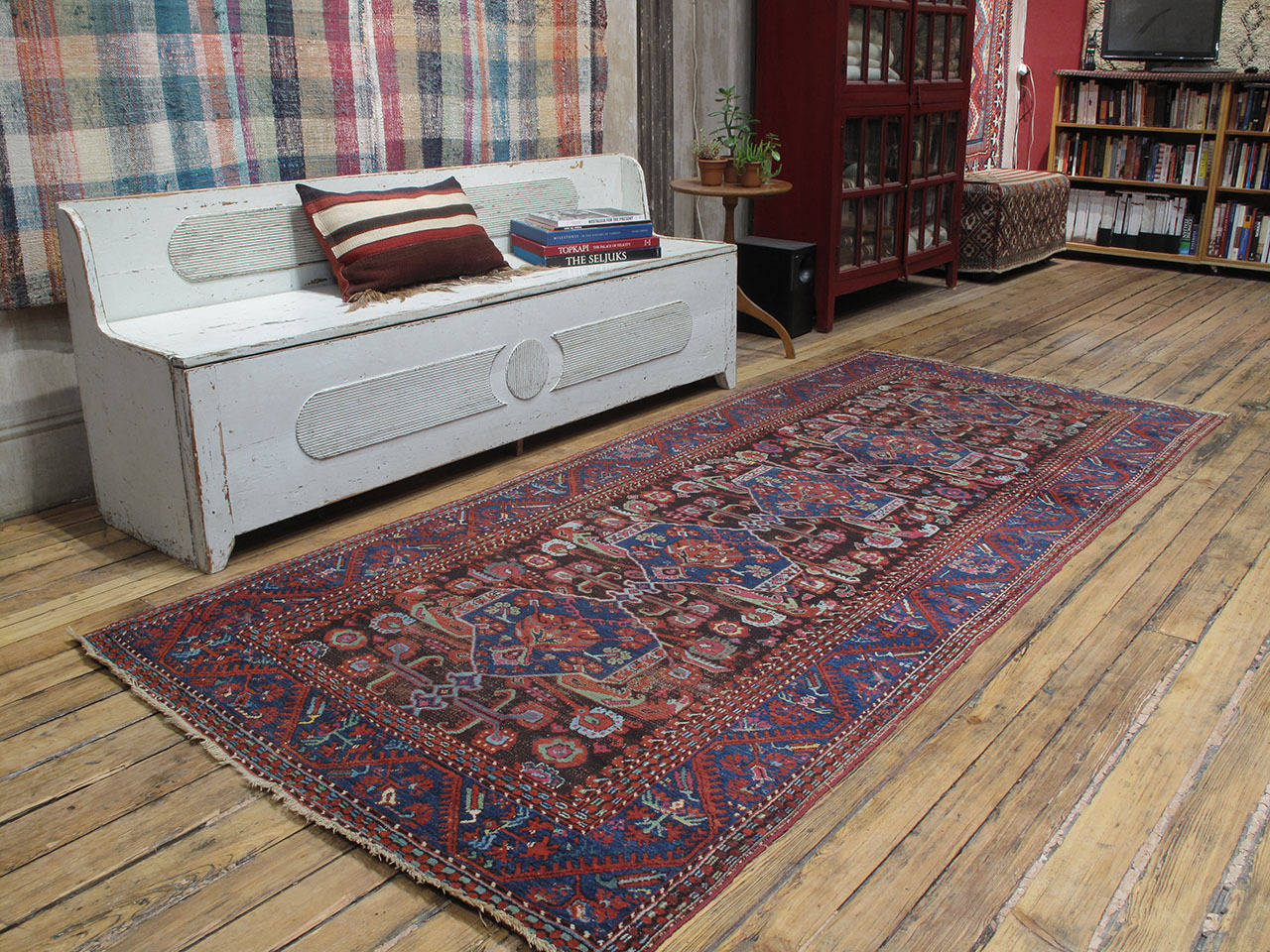 Antique Kula long runner rug. An older example of this well-known type of rug from one of the most prolific weaving centers of Western Turkey. With tulips and carnations and a profusion of other stylized floral forms, this antique village rug is a