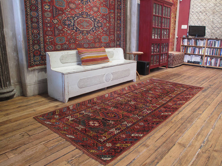 Antique Kurdish long runner rug. A beautiful antique rug attributed to the Kurdish tribes in the vicinity of the city of mosul in Northern Iraq, woven in the characteristic wide runner format, featuring a brilliant palette of natural dyes.