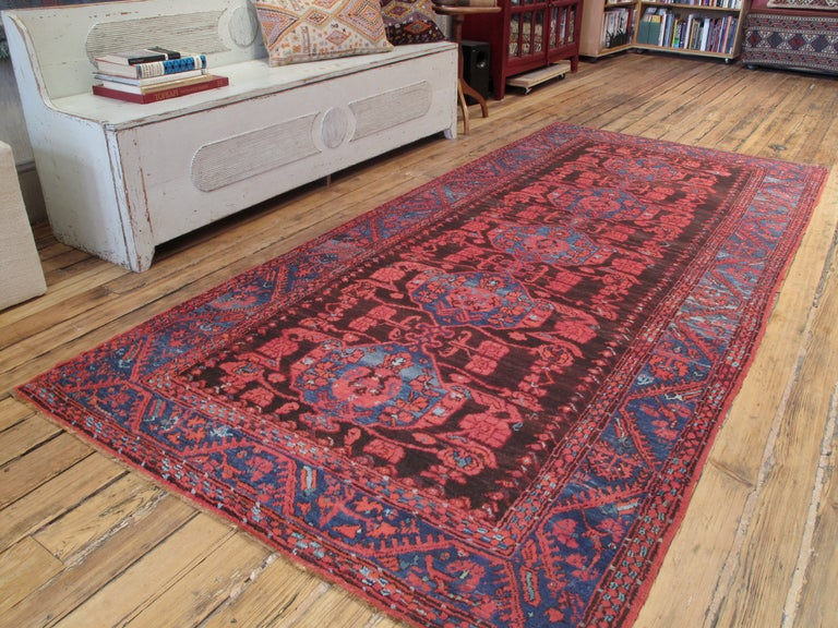 Antique Kula Long runner rug. With tulips and carnations everywhere, this antique village rug is a direct descendant Ottoman Turkish weavings from the classical period. A great example in excellent state of preservation.