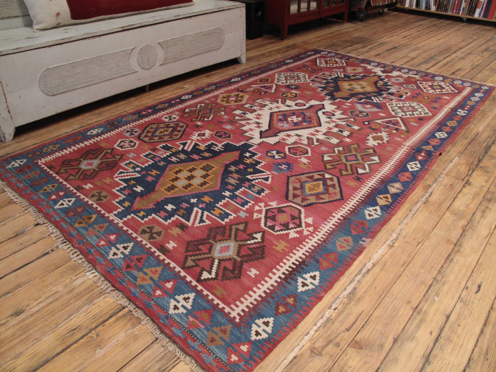 Kuba Kilim rug. An old tribal Kilim rug from the Caucasus with somewhat unusual design.