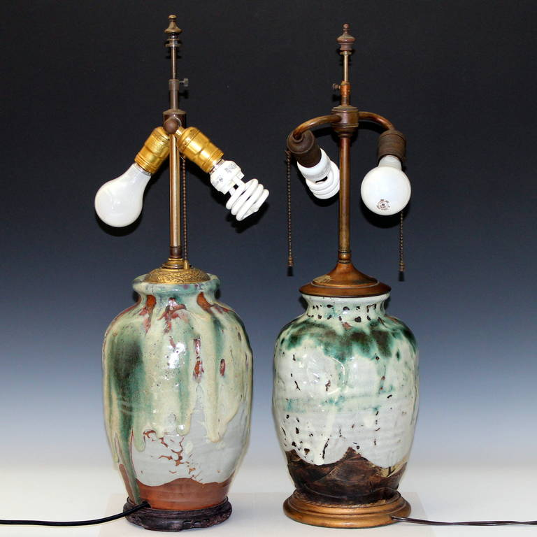 Similar pair of Awaji pottery tortured stoneware vases with heavy drip glaze, circa 1930, made into lamps. Nice double cluster sockets with risers. Shades not included.