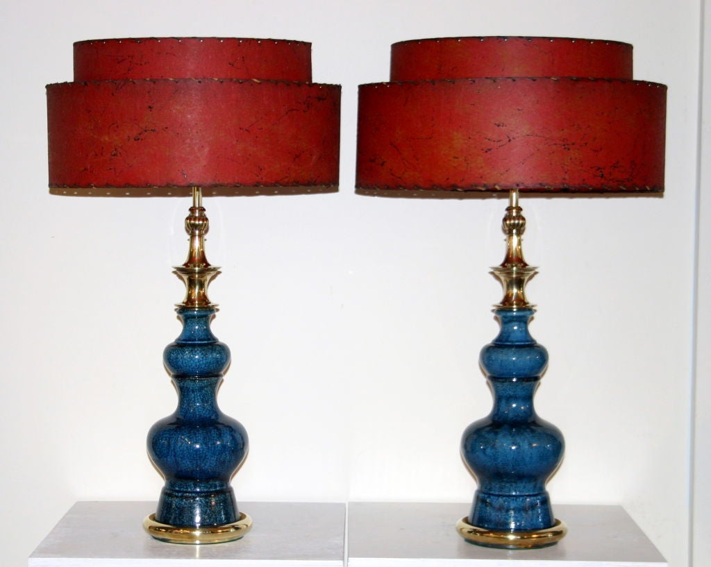 Pair vintage Stiffel lamps in blue crackle glaze pottery of double gourd form with rounded brass base and brass pagoda motif neck. Vintage two tiered fiberglass lampshades in great red/orange color.