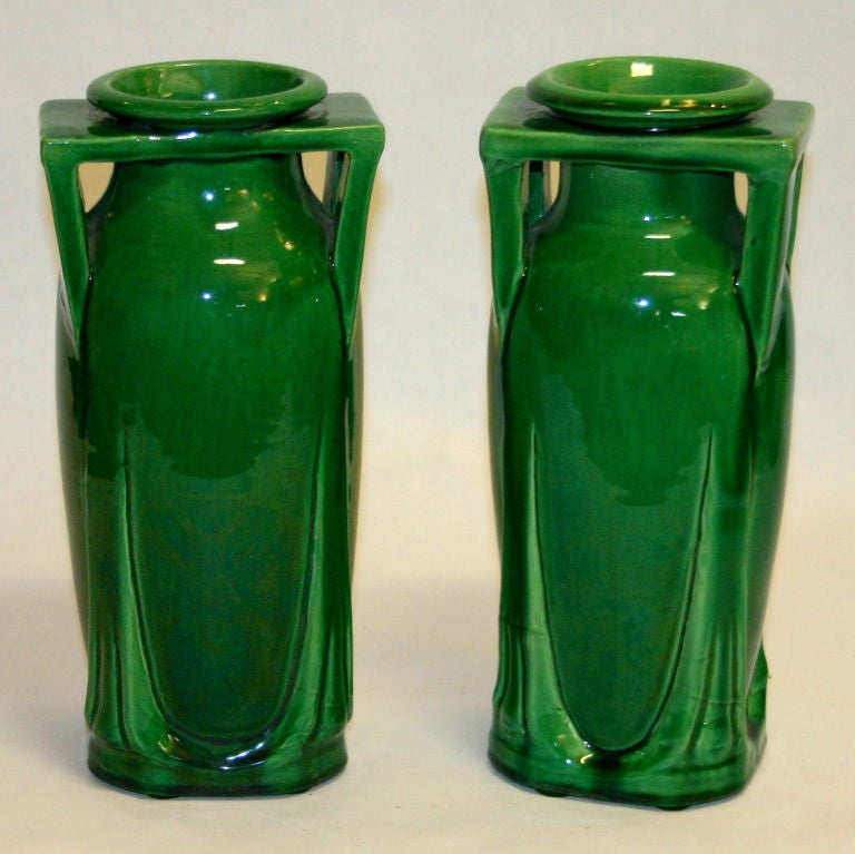 Pair of architectural Awaji pottery vases in deep green glaze.
