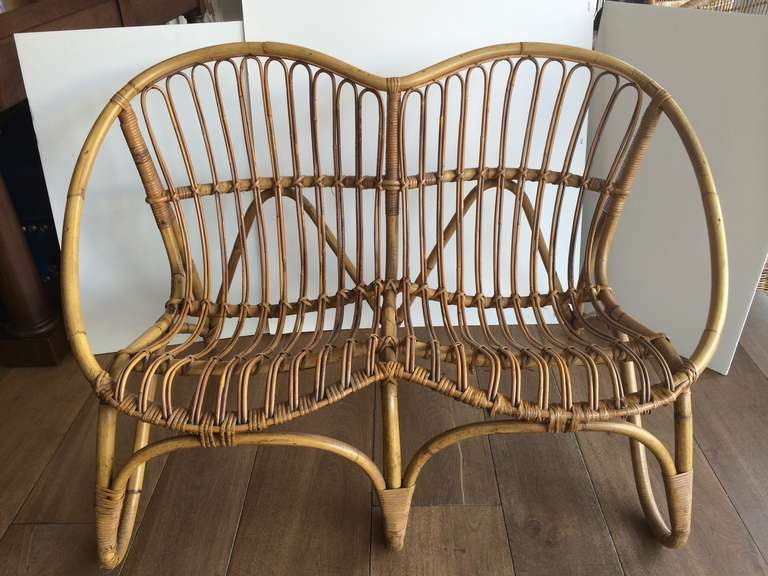 Small rattan loveseat from France.