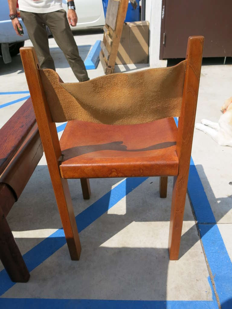Four th c leather and wood side chairs at stdibs