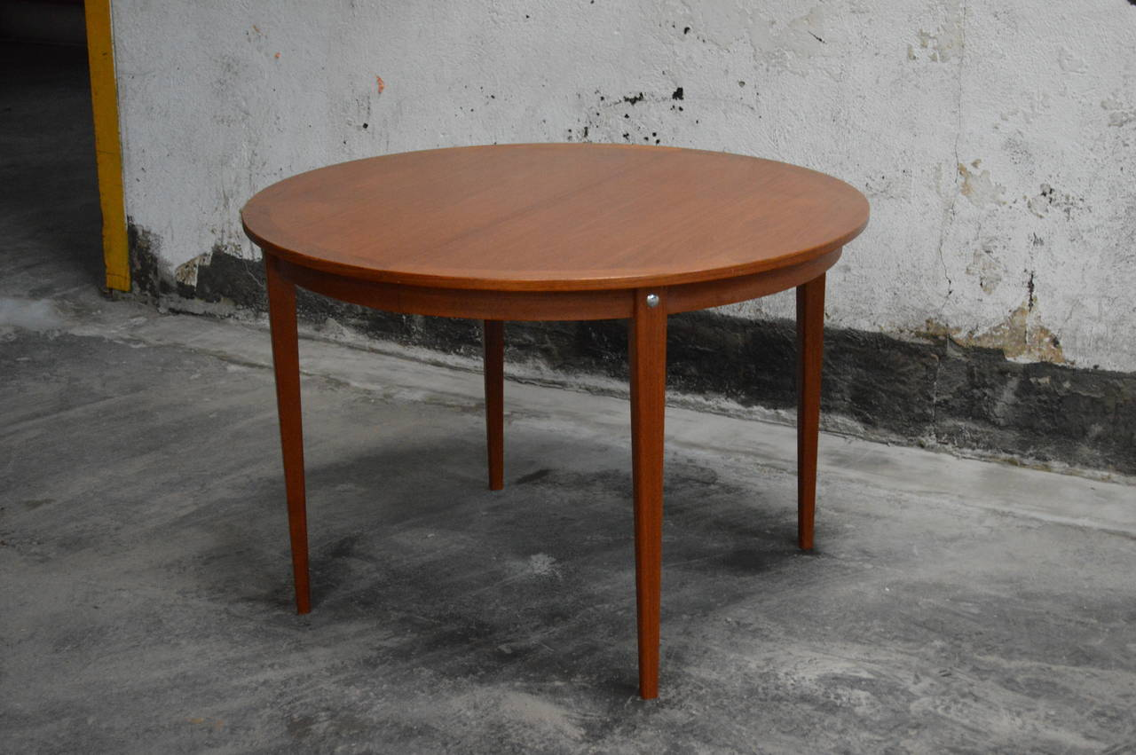 Mid Century Modern Round Swedish Teak Dining Table.
