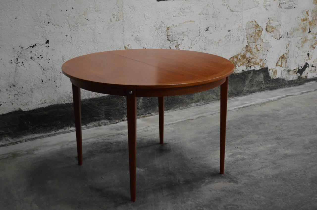 Mid century modern round swedish teak dining table at 1stdibs for Mid century round dining table
