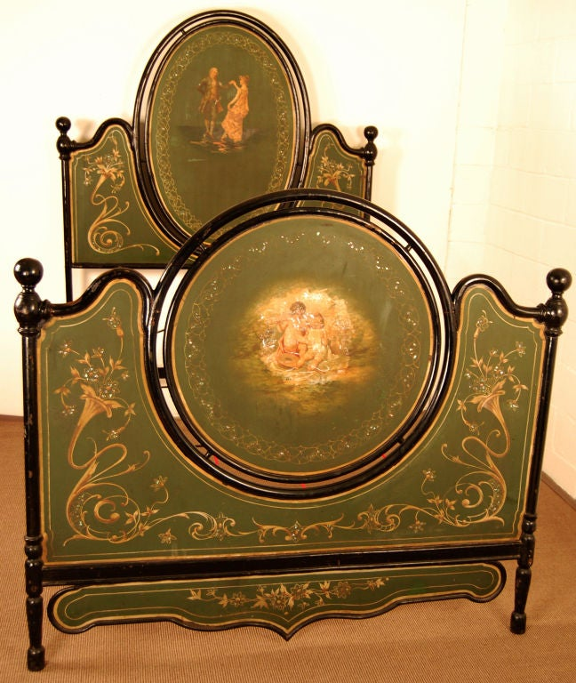 Magnificent cast iron bed with polychrome enameled metal inset panels with neo-classical motifs and mother-of-pearl accents.  Bed has been altered to fit a standard US queen-sized mattress.  Included in sale is custom box springs which is easily