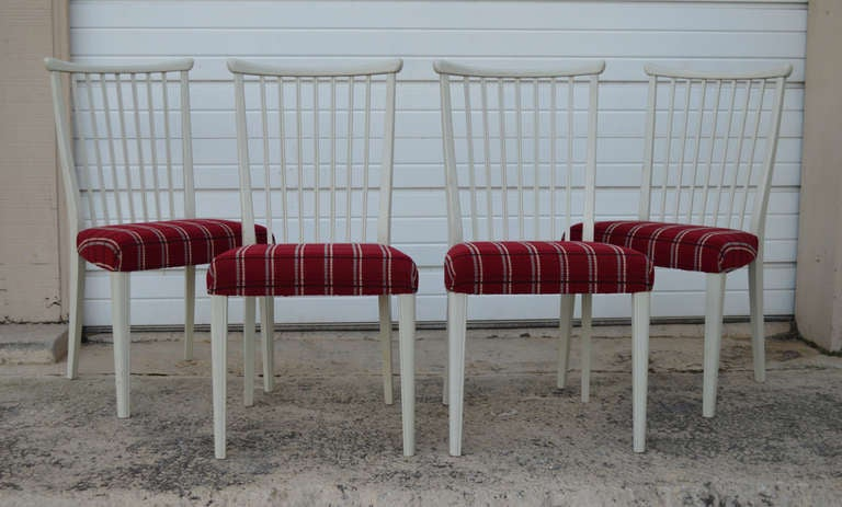 Set of Four Mid-Century Gustavian Style Dining Chairs. Lacquered a creamy off white with original burgundy red plaid upholstery. Price includes reupholstery of the chairs in COM fabric.