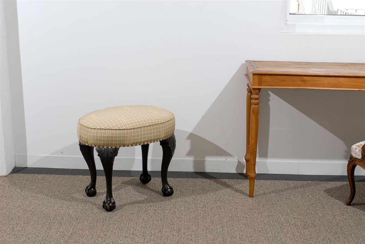 Late 19th century Chippendale ball and claw oval bench.