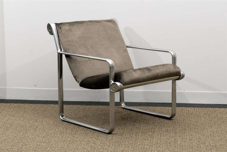 An absolutely stunning pair of the iconic lounge chair designed by Bruce Hannah and Andrew Morrison for Knoll, circa 1970s. Aluminum with polished stainless steel accents. This rare arm version (most of the production was slipper style) has been