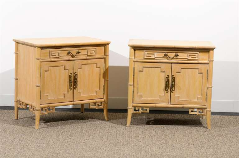 A Wonderful pair of cerused faux bamboo small chests by Ray Sabota for Century Furniture Company, circa 1970's. Brass hardware and lovely Greek Key motifs accent the pieces. Functional scale will allow for use as end tables or night stands.