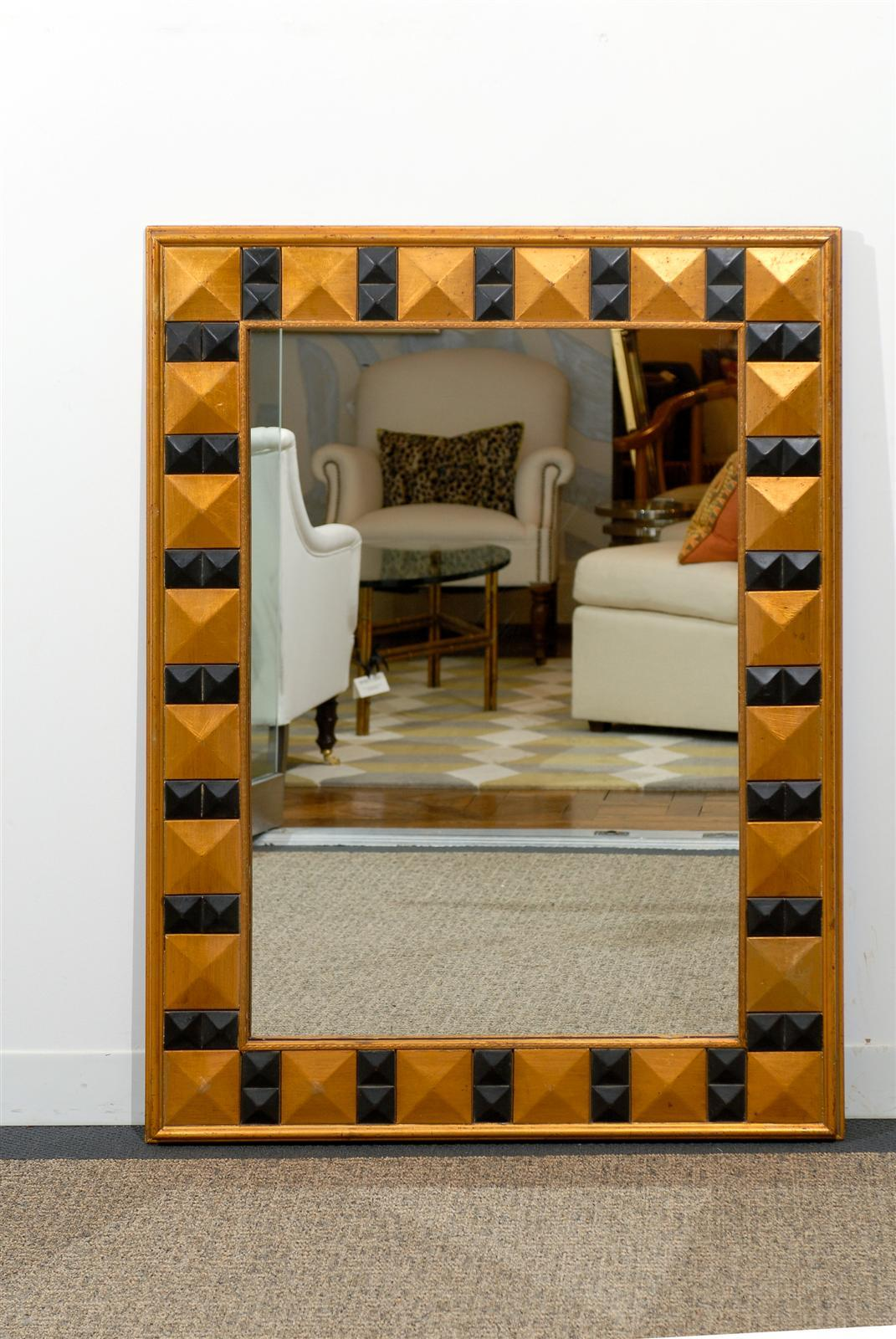 Mid-20th century giltwood and painted beveled mirror. Very striking statement for any room.