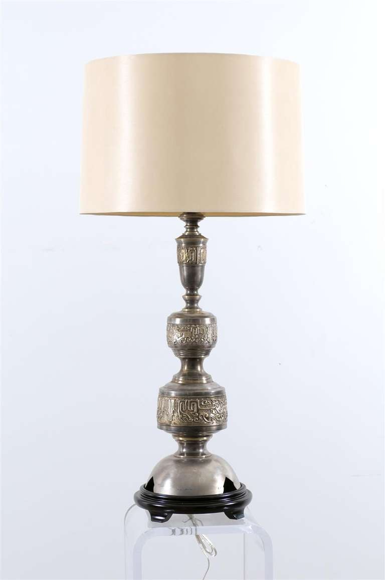 An Absolutely Stunning pair of large scale Marbro lamps. Components imported from India and assembled in the lighting workroom in Los Angeles, California circa 1960.  Solid brass with a pewter finish. Asian motif details in brass. Fantastic