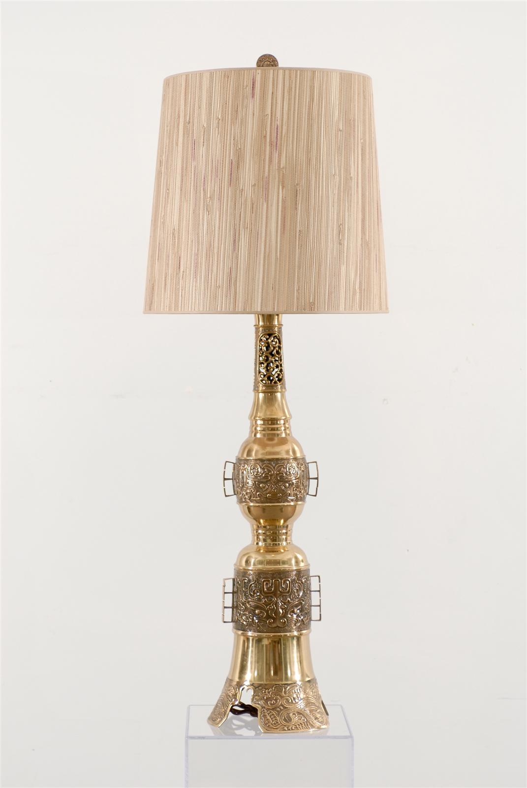 Chic pair of Asian brass lamps and finials in the John Mont style rewired with brown silk cording.