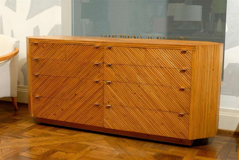 An exceptional vintage split bamboo ten drawer chest, circa 1970. Beautiful case design with handsome brass hardware.  Diagonally applied split bamboo veneer over mahogany case construction. Stout and expertly made with painstaking attention to